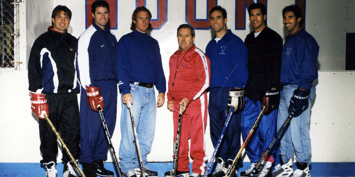 Mount St Charles coach Bill Belisle with some of his NHL graduates